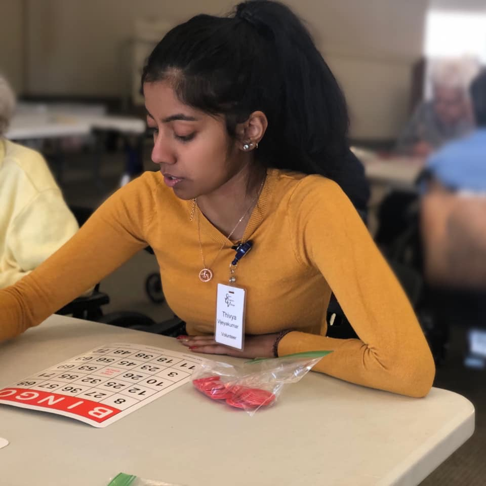 Volunteer Playing Bingo at Sayre Christian Village